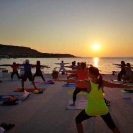 Yoga itinerante al tramonto